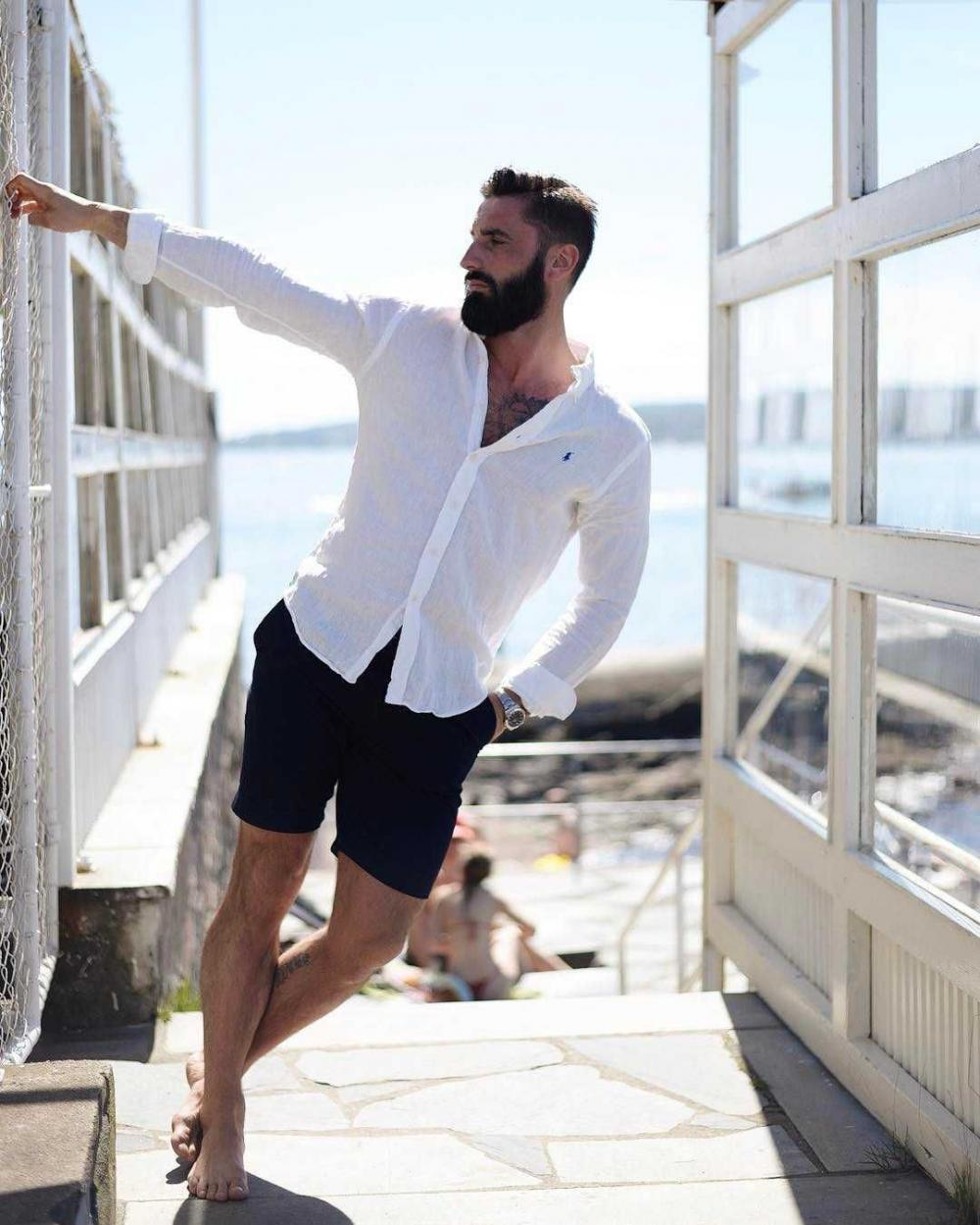 A classic combination of white shirt and black shorts - your perfect outfit for this summer