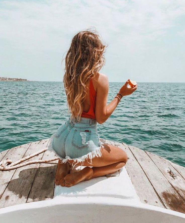 A red wave top and ripped denim shorts are your go-to outfit for a new day at sea