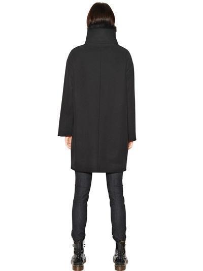 Season of coats. Choosing warm clothes for walking