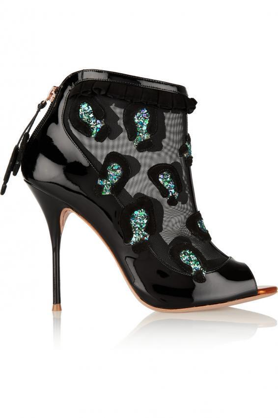 Admiring the beautiful brand shoes. Cold season boots.