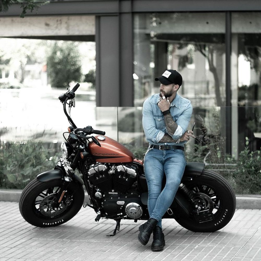 Blue jeans and a denim shirt are a great combination for a biker look