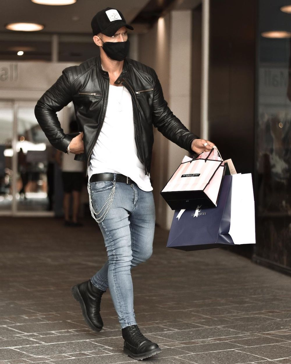 When looking great in a black leather jacket and skinny grey jeans, do not forget a face mask