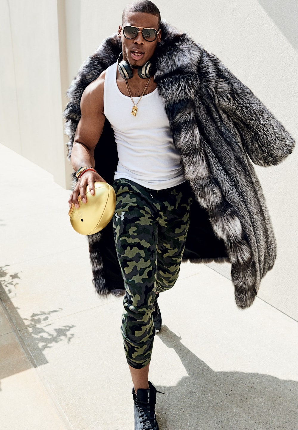 Cam Newton's outstanding fur coat look. An excellent example of a great men's outfit