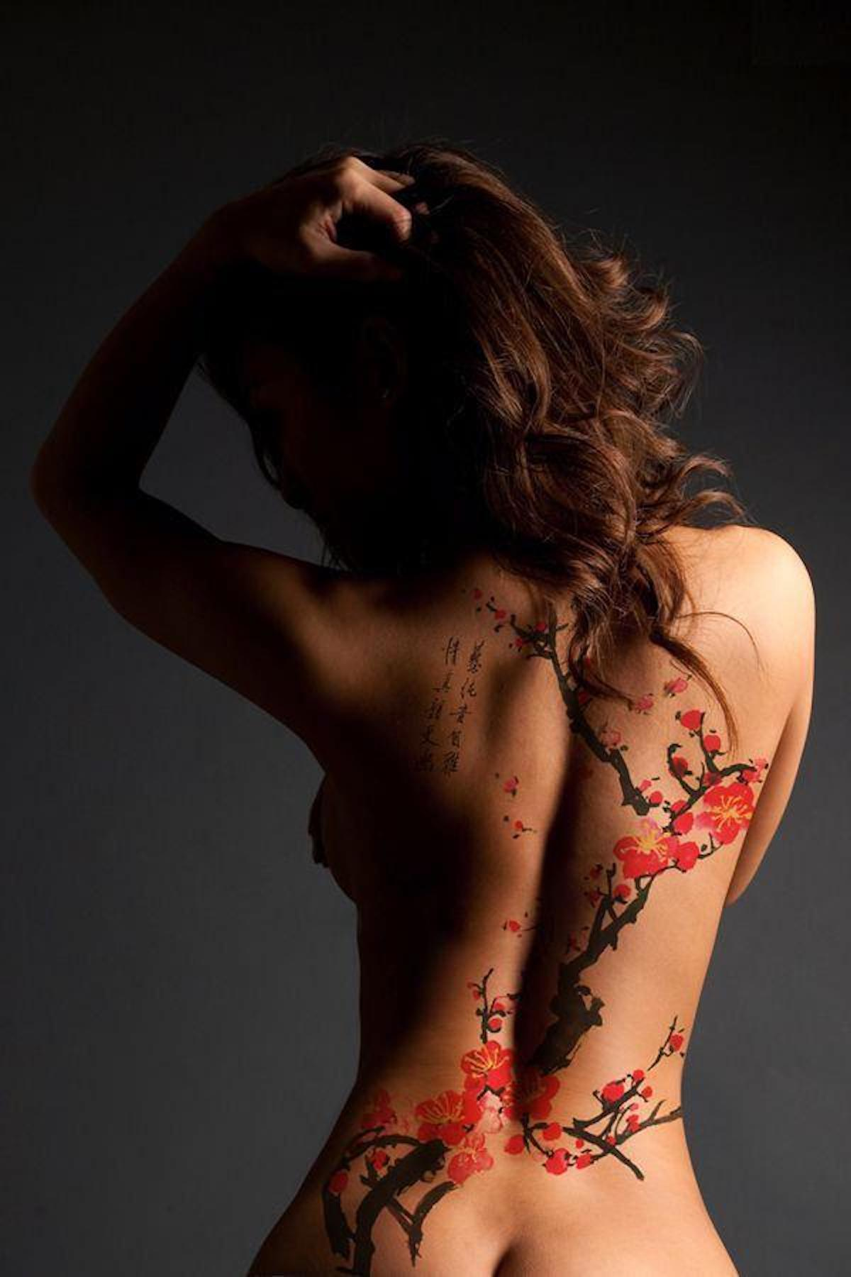 Sakura blossom tattoo in the sexy woman's back