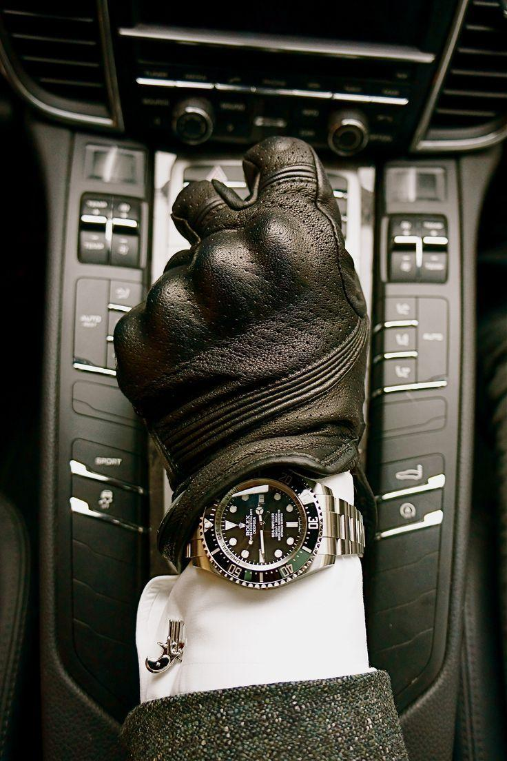 The main detail of the image of a man is accessories. Choose men's gloves for driving correctly