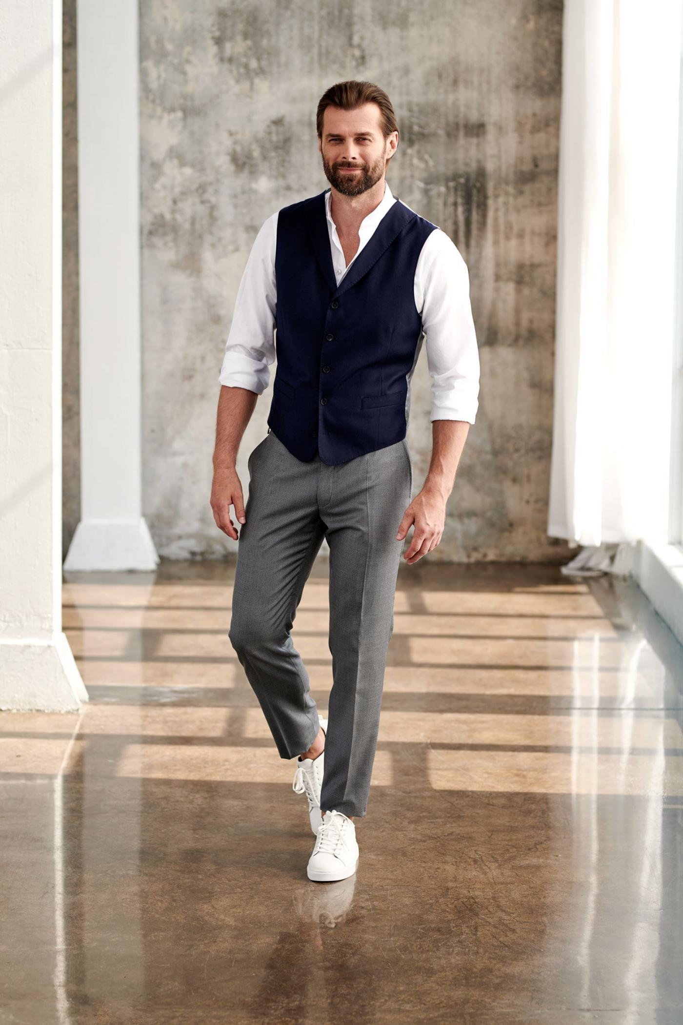 Cocktail or evening party men's look: vest, shirt, pants and low-top trainers