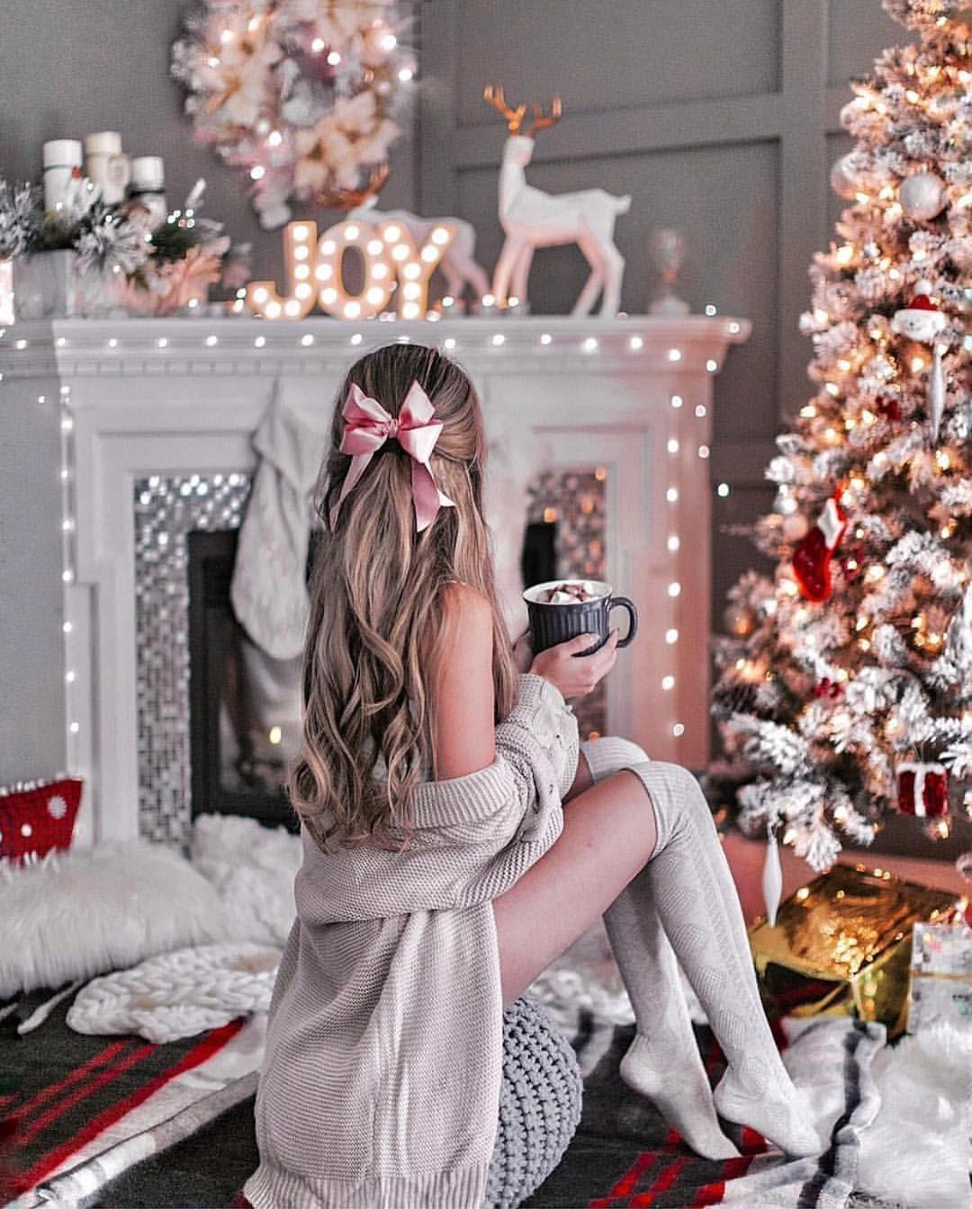 Beautiful girl in stocking and ribbon in long hair drinks her holiday coffee