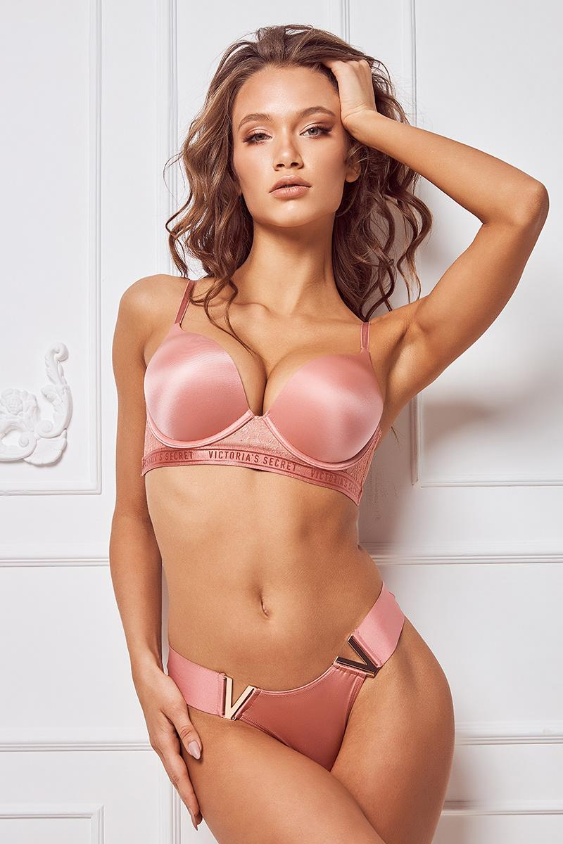 Seductive woman wearing satin pink bra and panties from Victoria