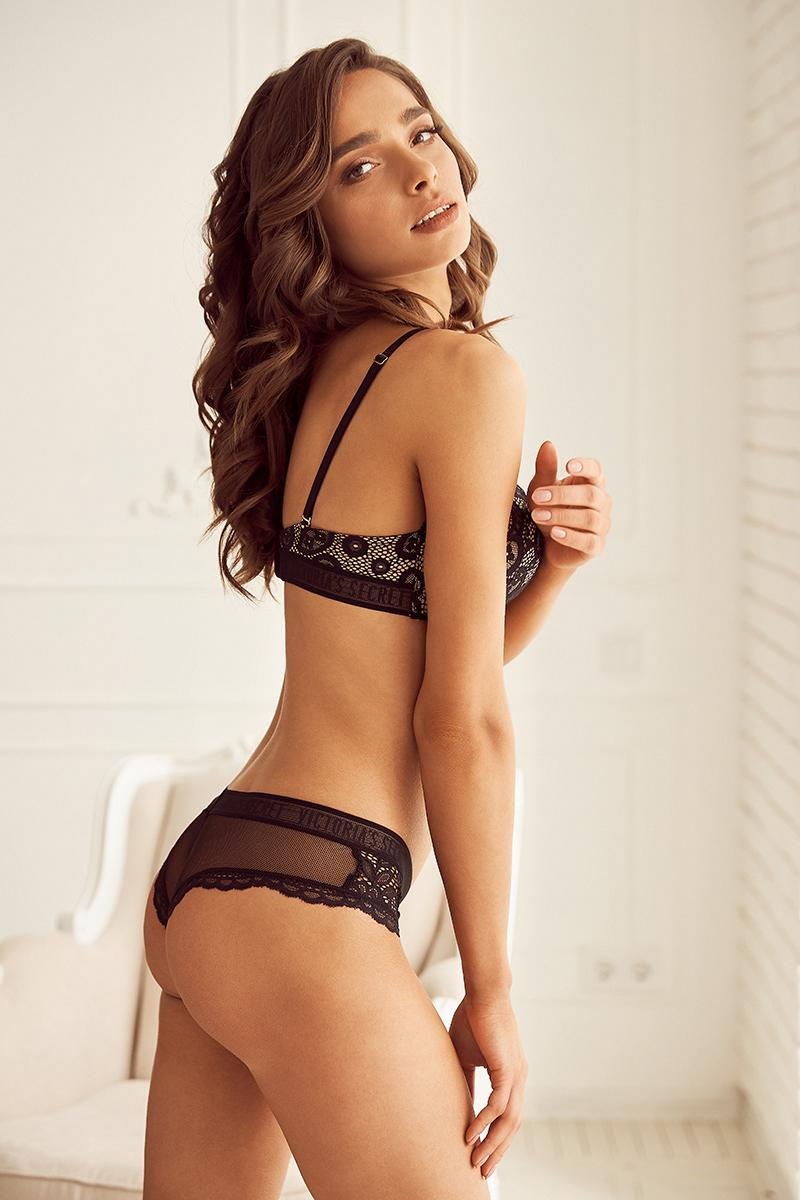 Model posing on black transparent lace underwear