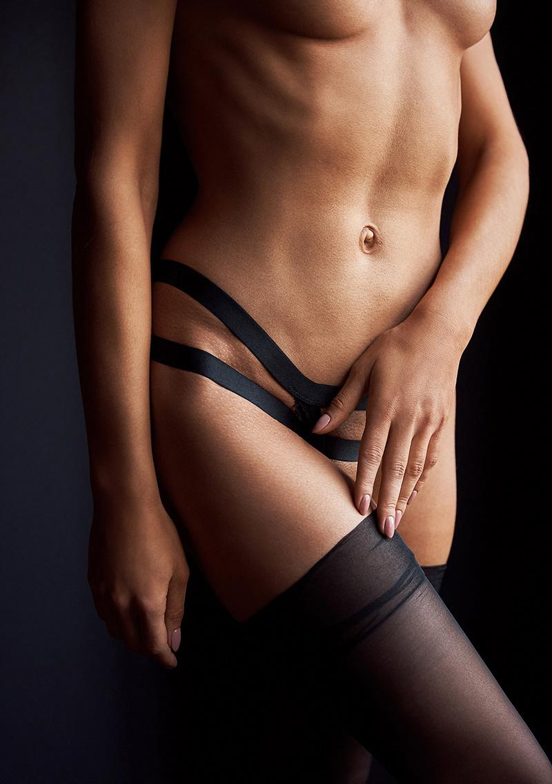 Sexy fit woman dressed small black panties and stockings