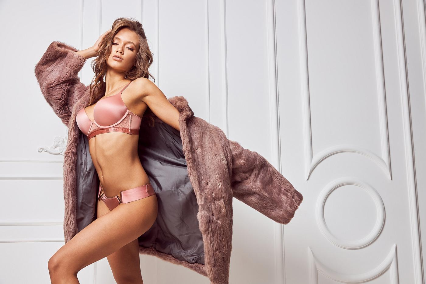 Woman dressed pink underwear set and fur coat