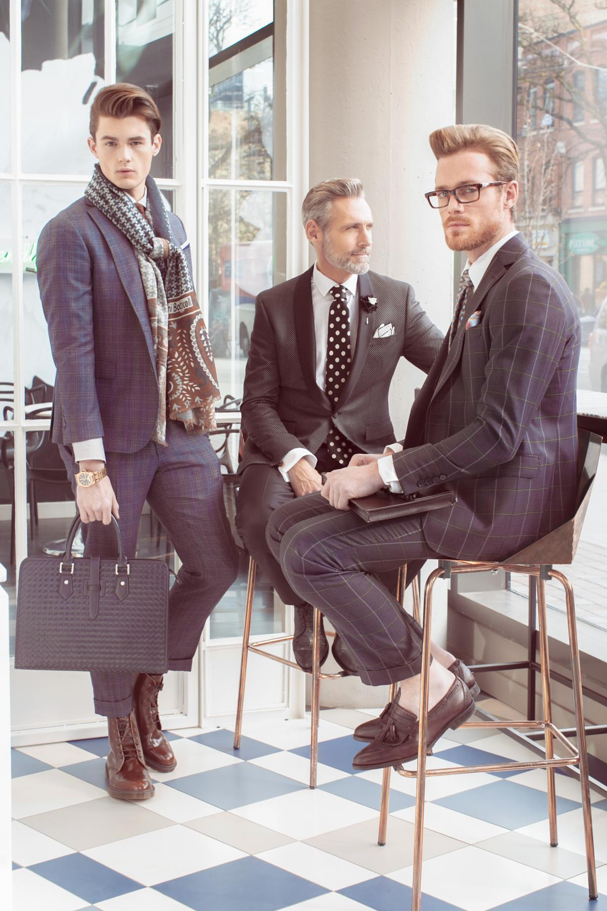 Three stylish men in suits waiting for the business meeting