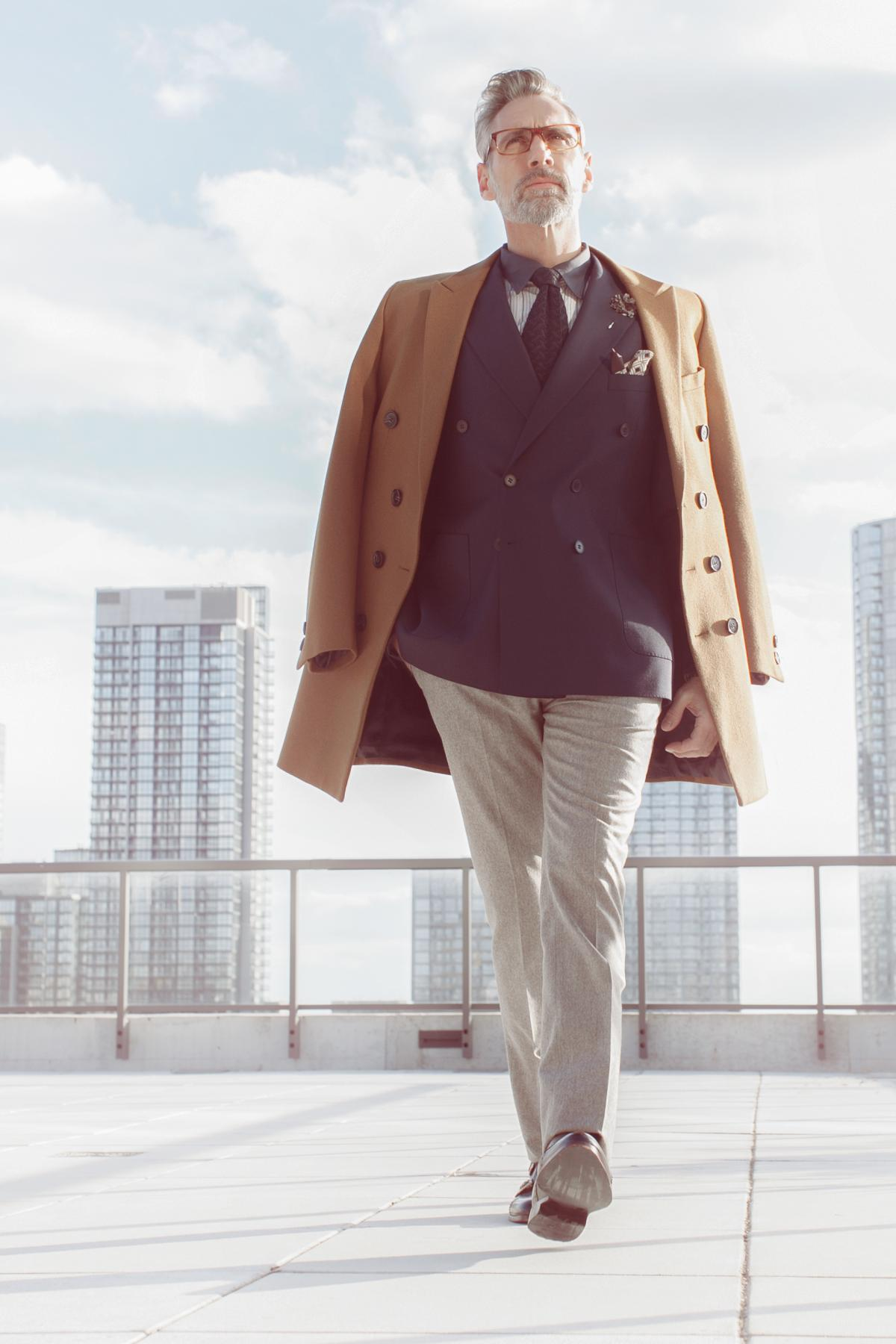 Expensive look for successful man. Dark jacket, light pants and brown coat for cold season