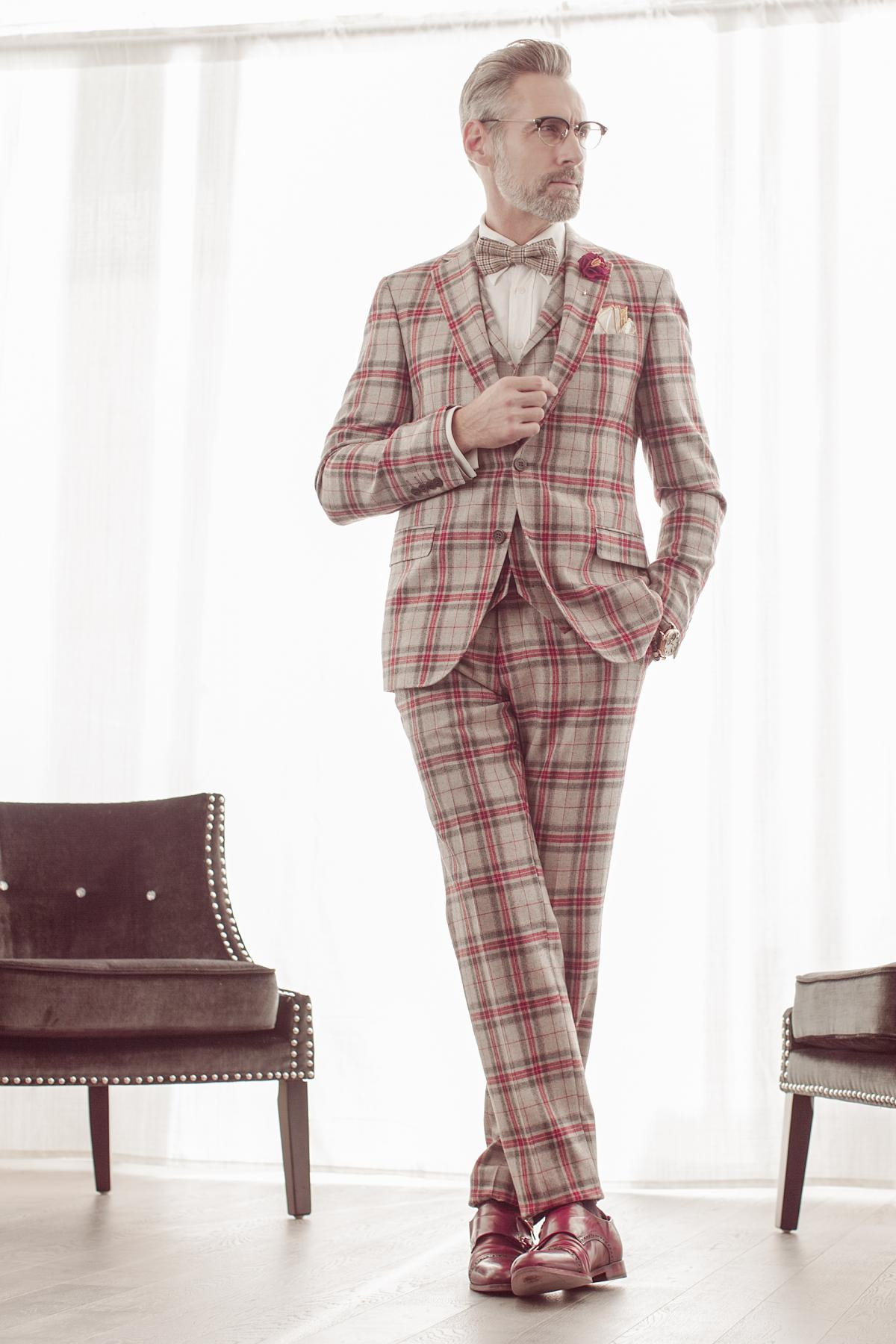 Expressive style of a man in classic suit with red squares