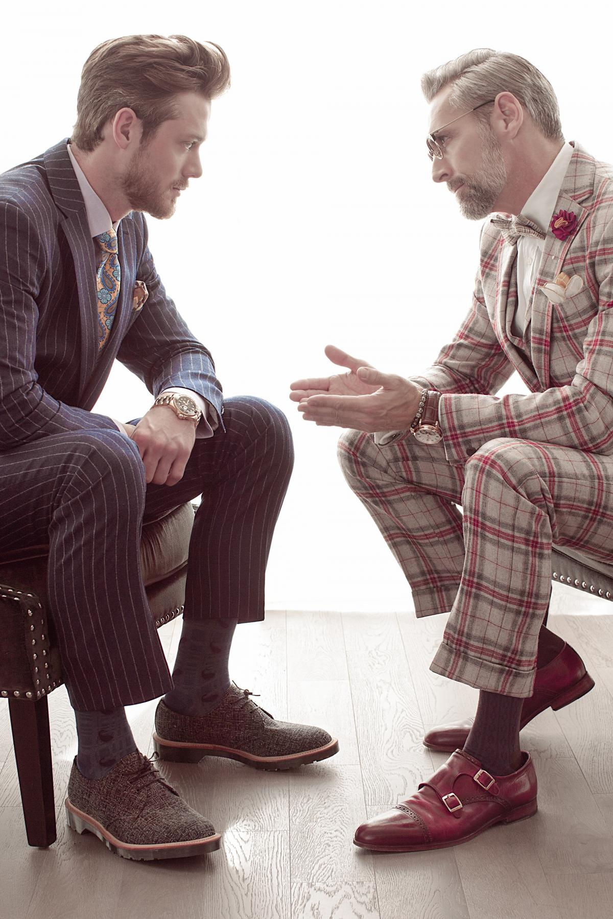 Two perfectly dressed men discuss an important business