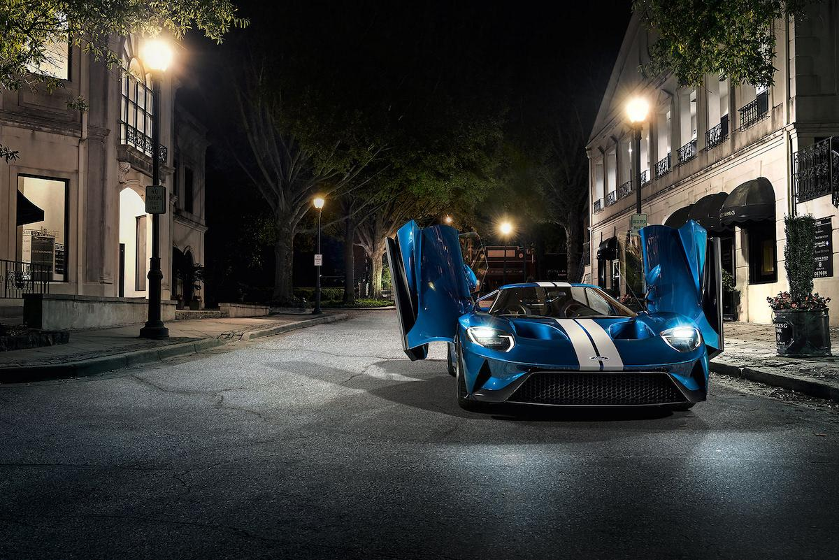 Aggressive sport styled blue Ford GT supercar 2019 with white stripes