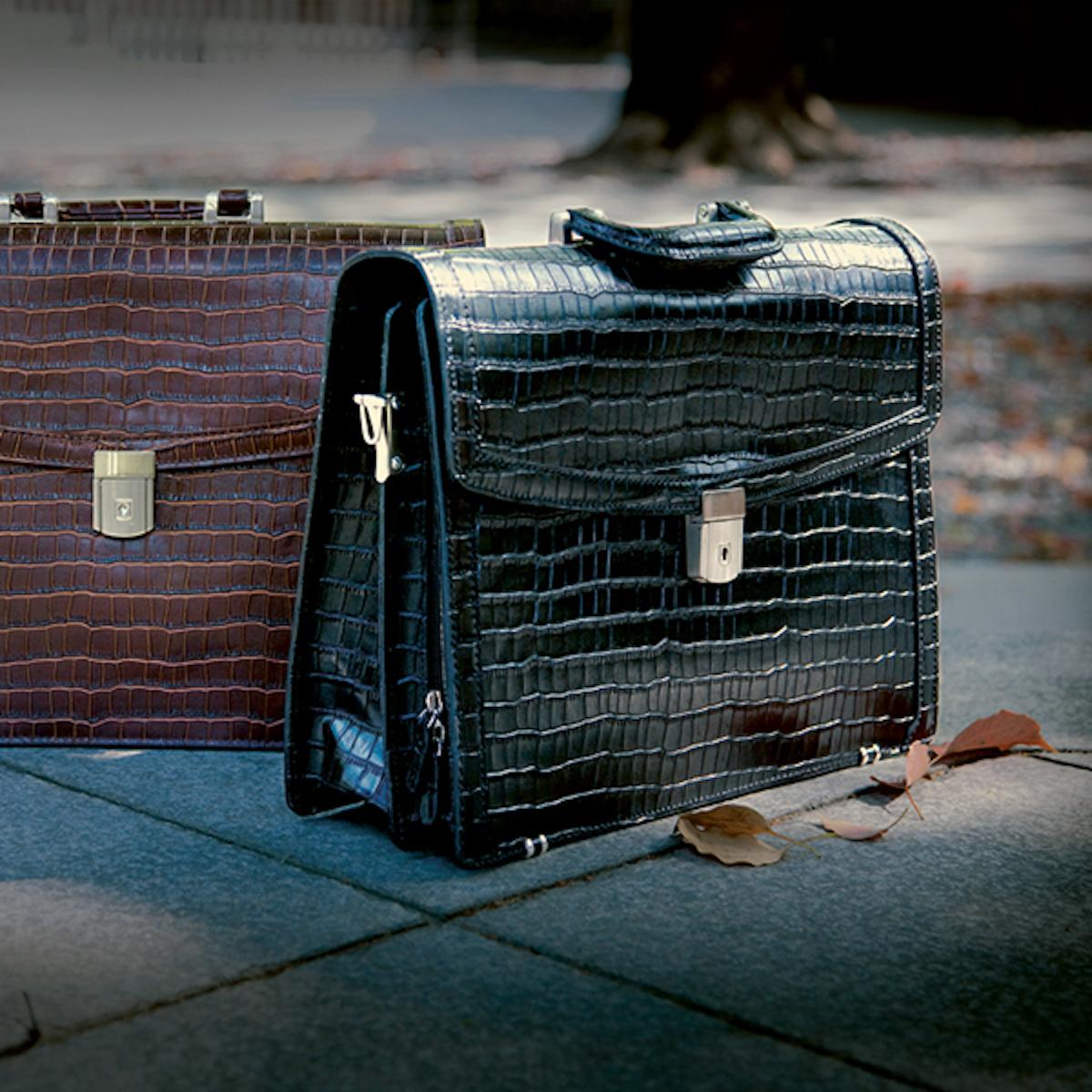 Black and brown embossed bags in crocodile style