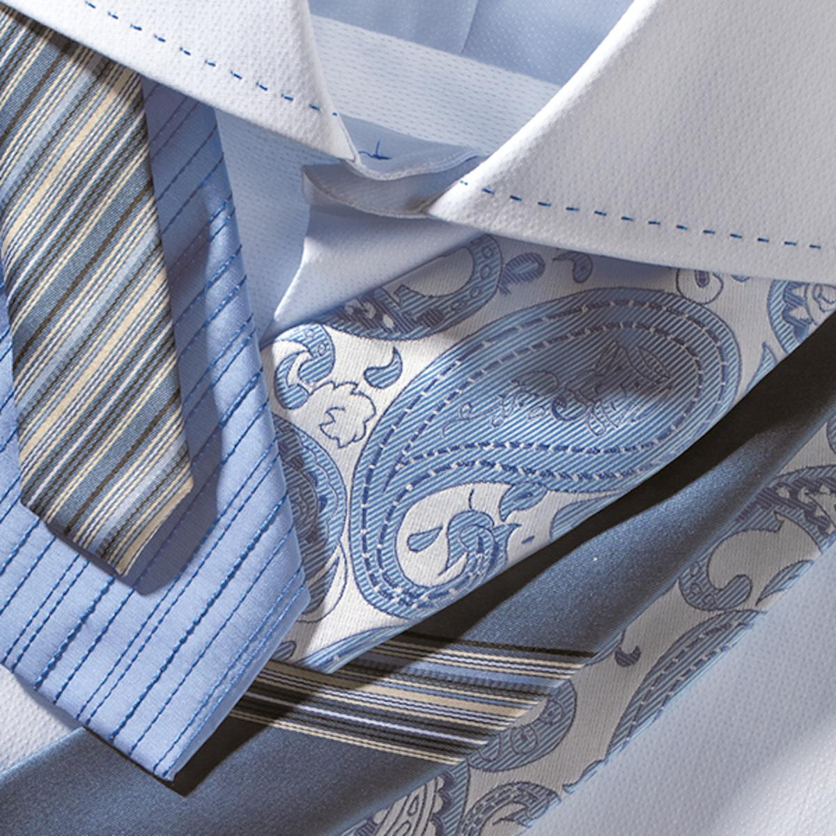 Idea of combining a white shirt with different ties, striped or patterned
