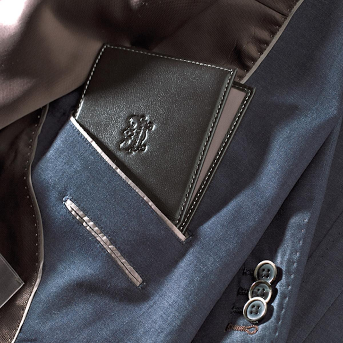 Good combination of dark colours and materials for blazer and wallet