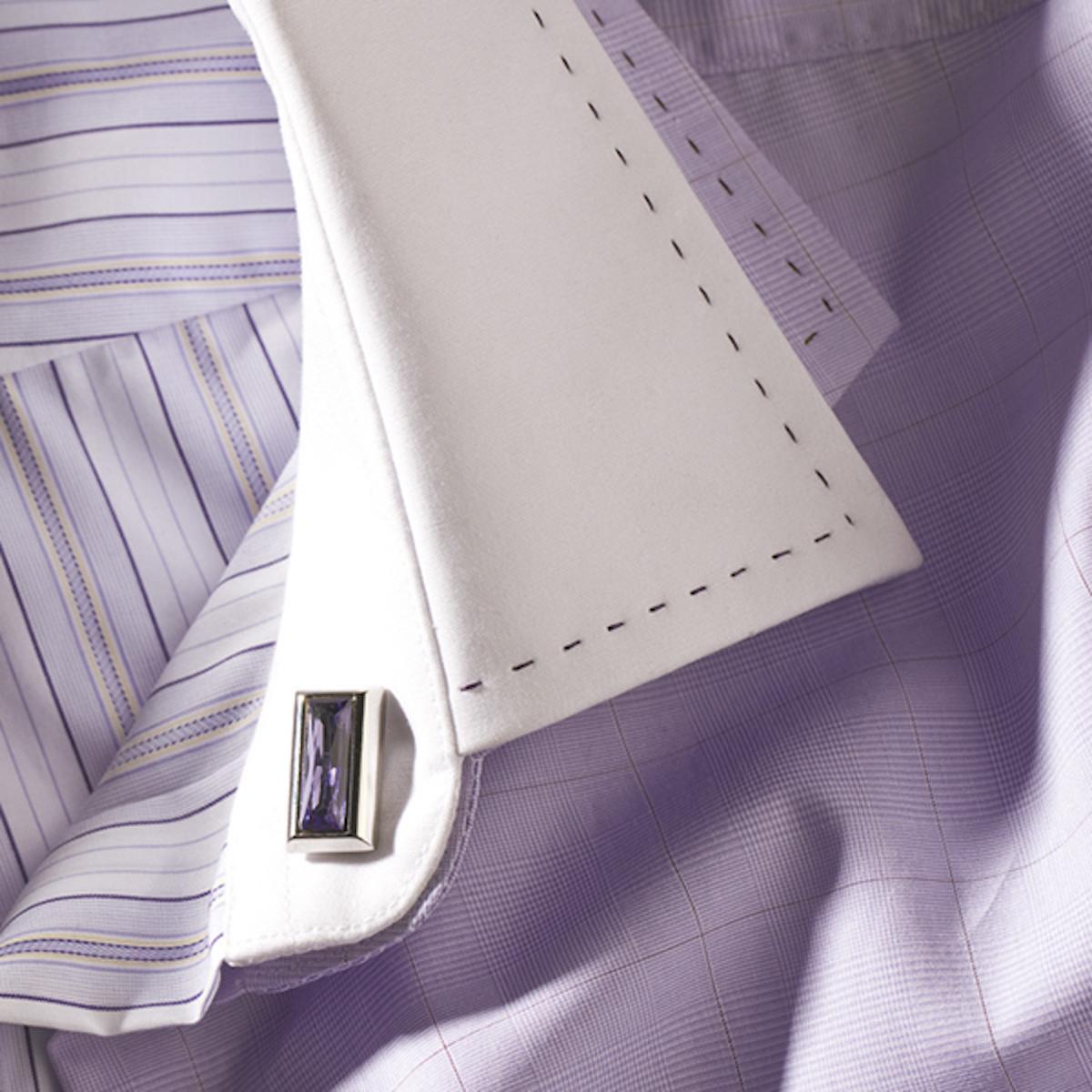 Combination of light blue shirt and violet cufflink