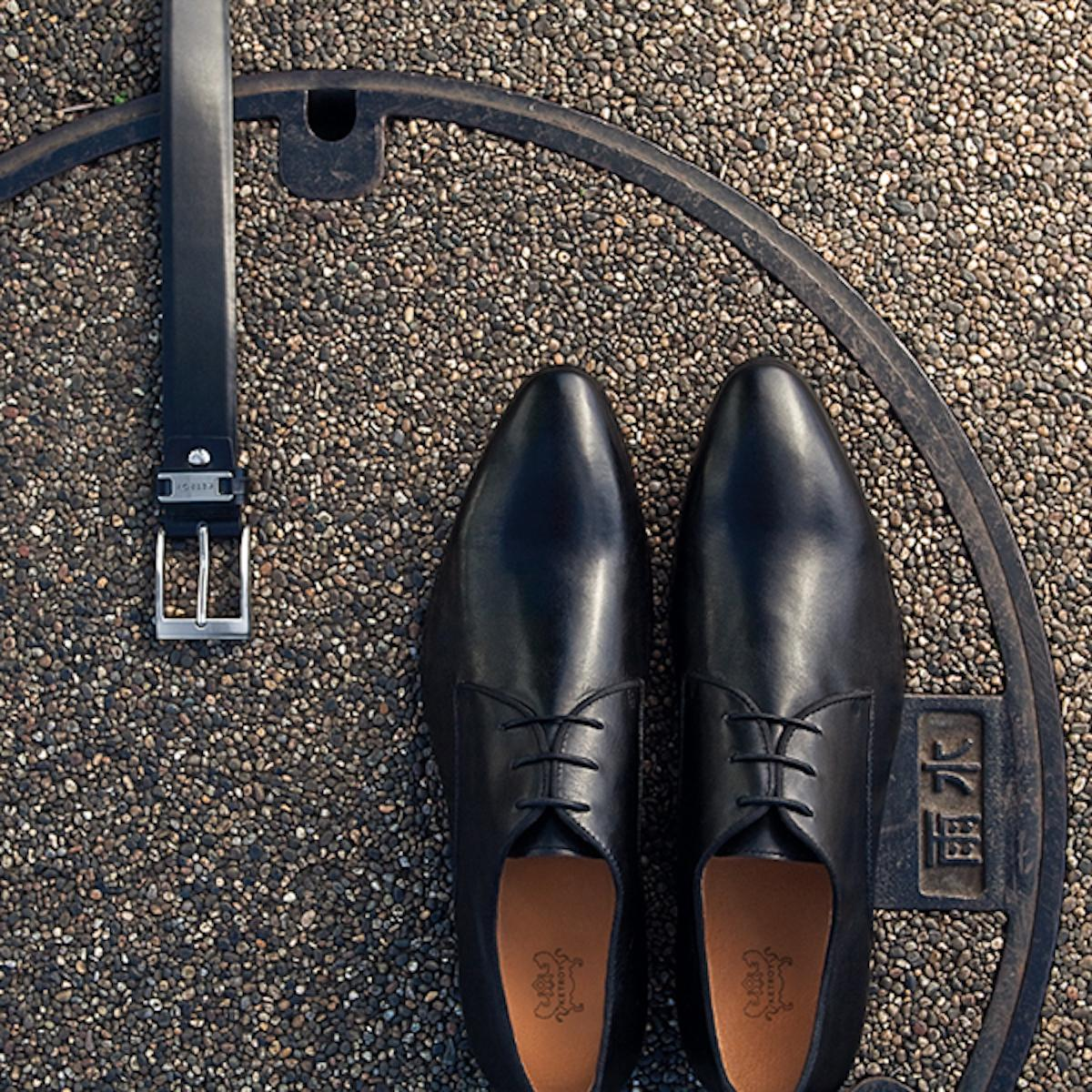 Combination of black classic shoes and black belt
