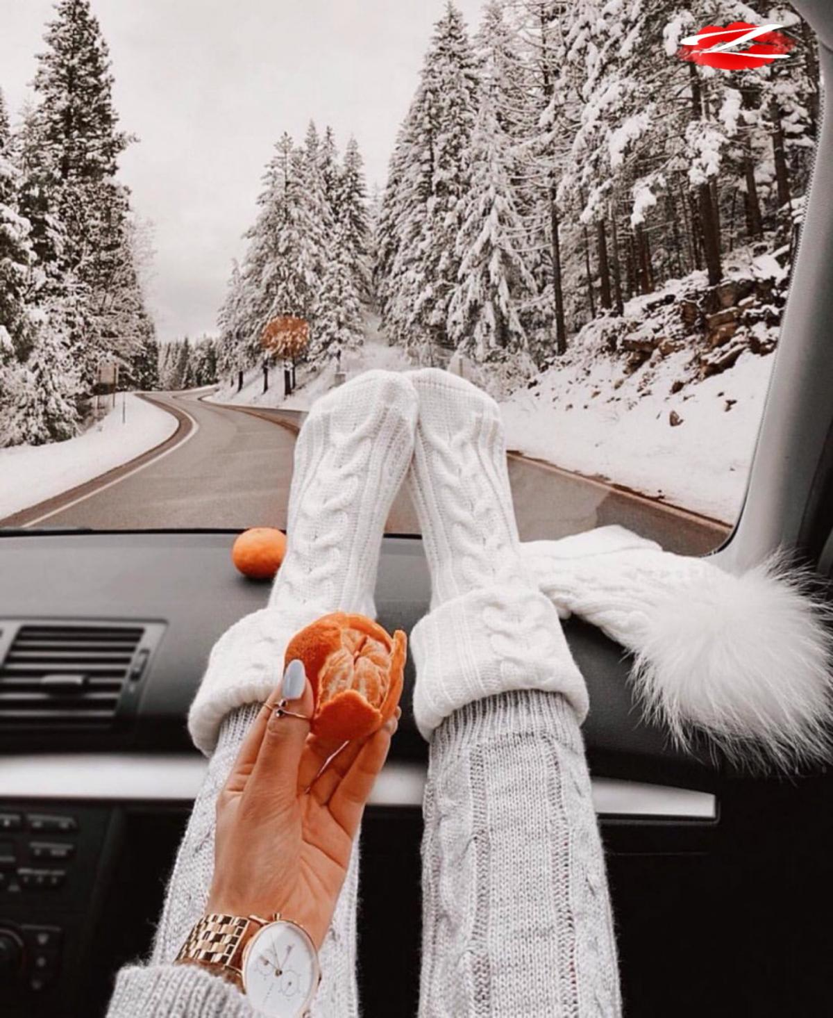 Comfortable trip to mountains. White girl' s socks and clementine