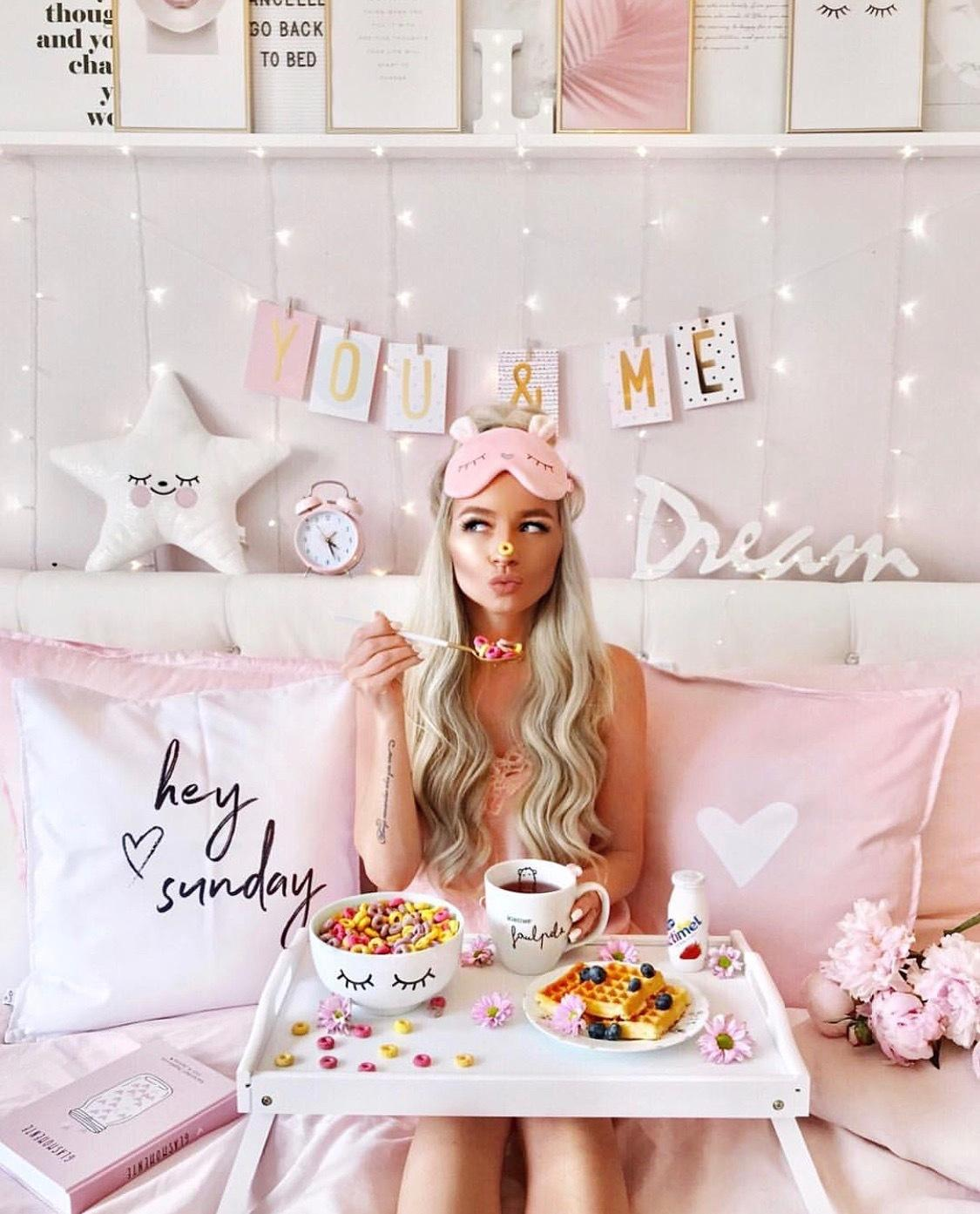 Pink holiday madness. Beautiful girl enjoys morning coffee and sweets