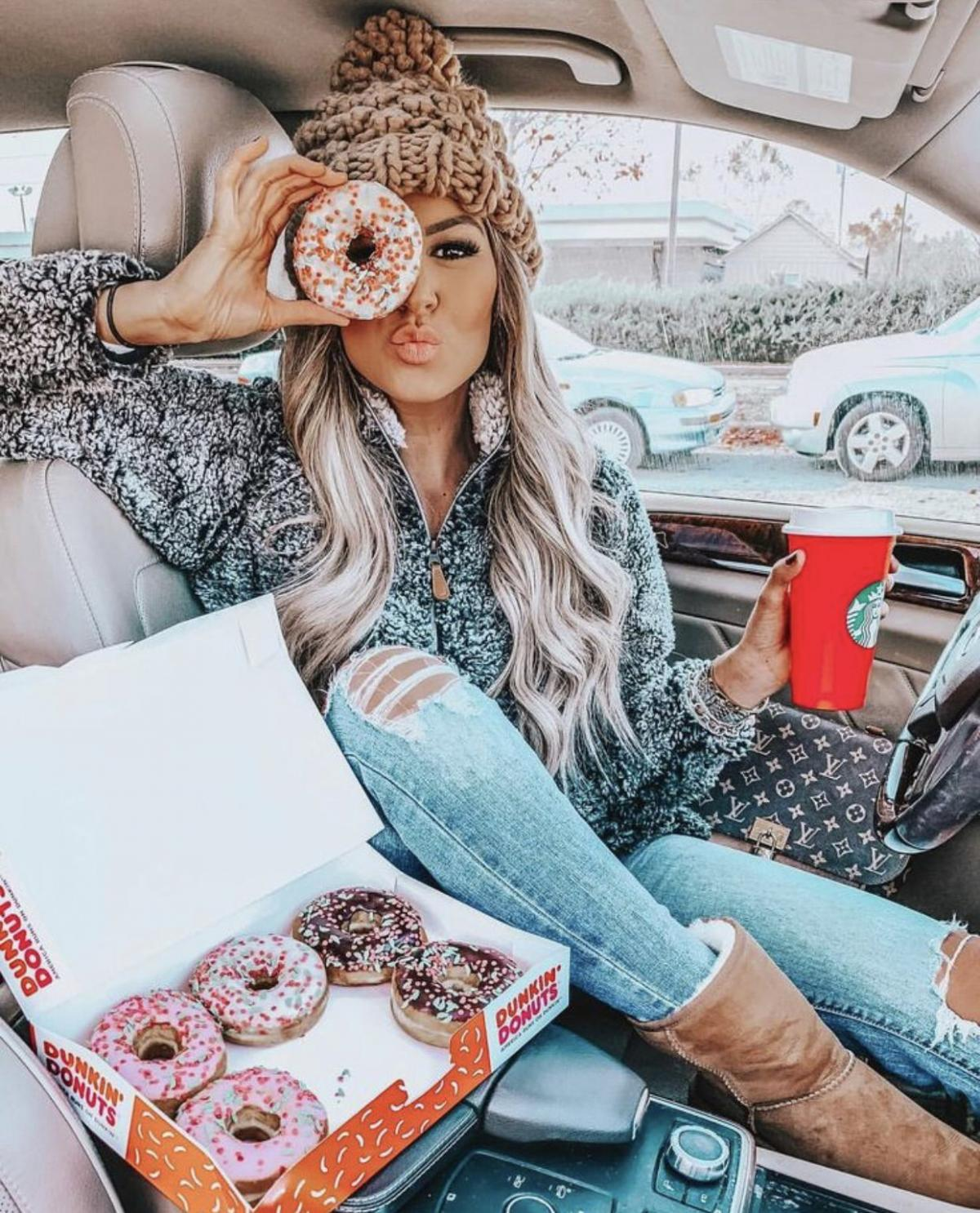 The best stop while traveling is a donut stop. Sexy girl got one and coffee