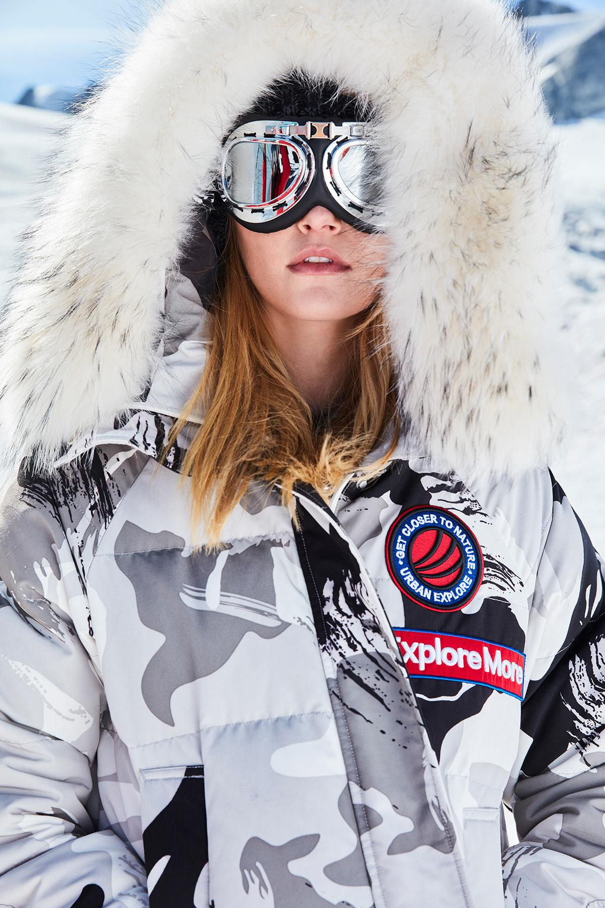 Beautiful white winter jacket with fur hood will make you look like professional skier