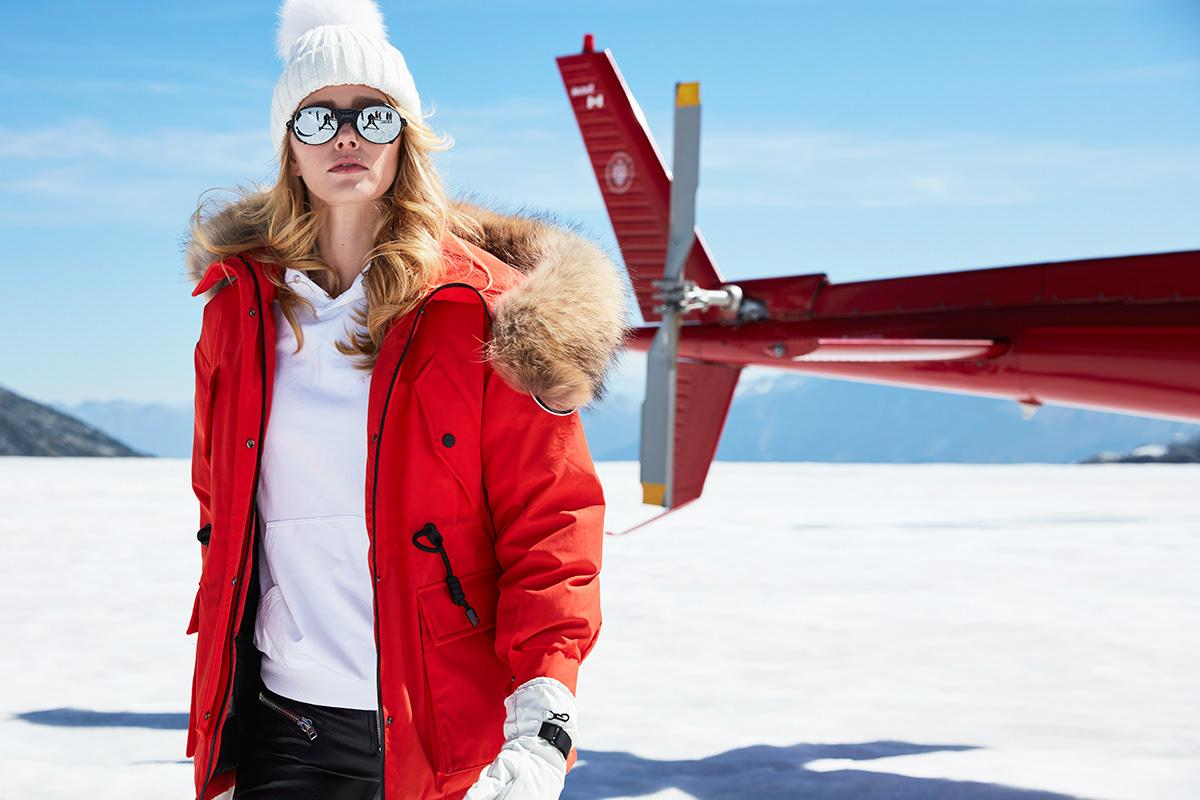Red parka with fur hood is the best option for mountains exploring