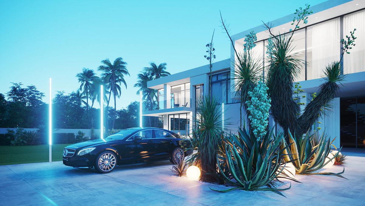 Night photo go two-storey house with parked car and greenery