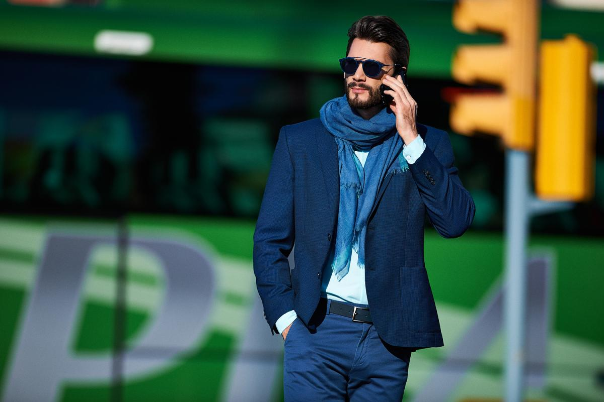 Blue blazer combined with scarf is the perfect casual combination for men