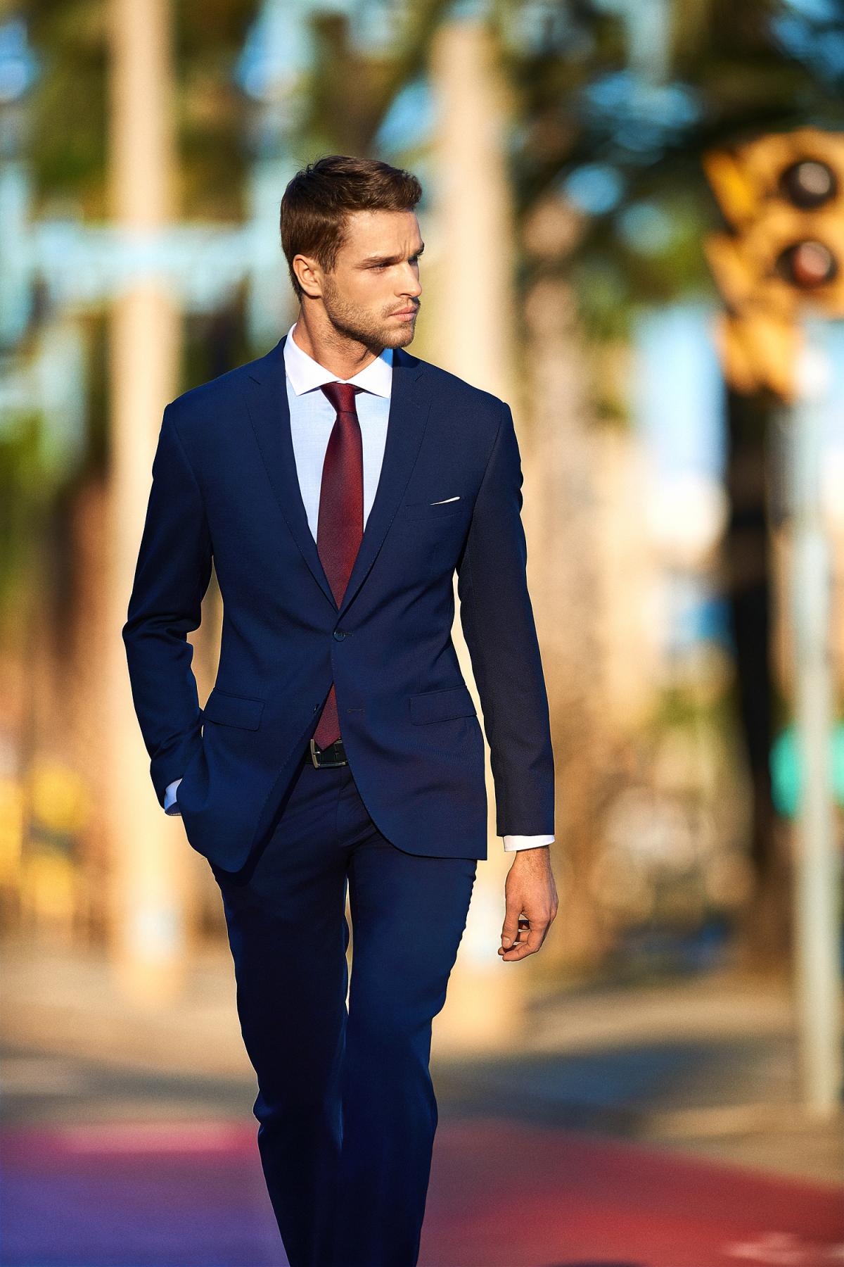 Another one classic business style - dark blue suit, white shirt and red tie