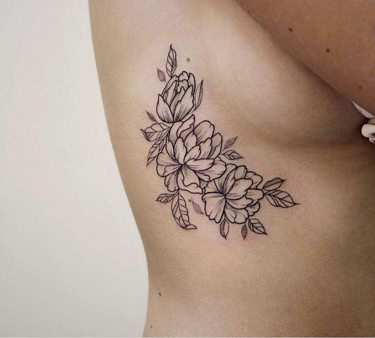 Beautiful rose tattoo above boobs for romantic women