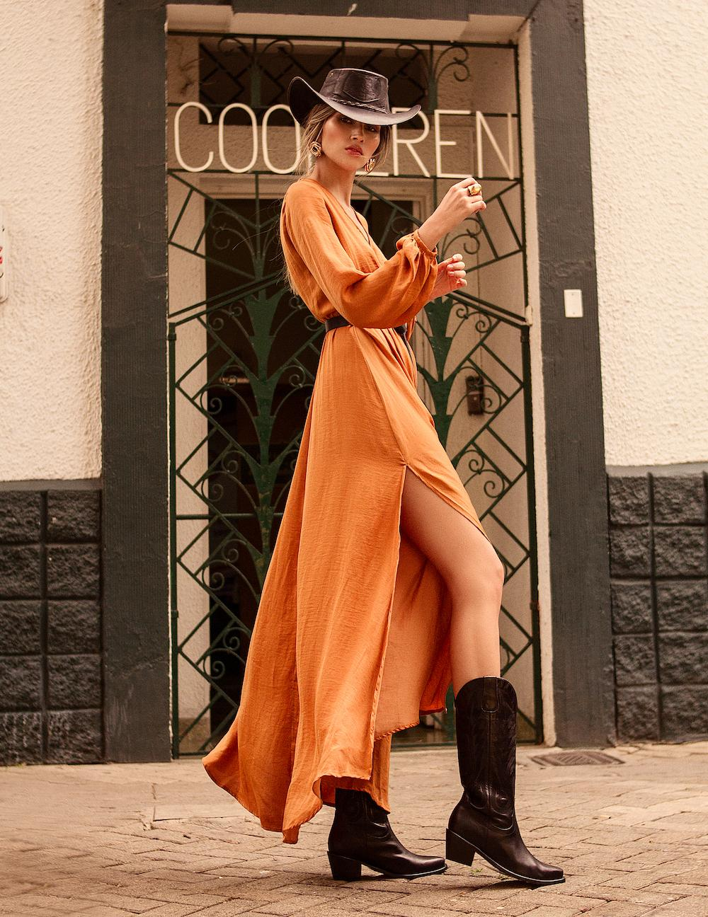 Bright and light long orange dress to create modern cowgirl style