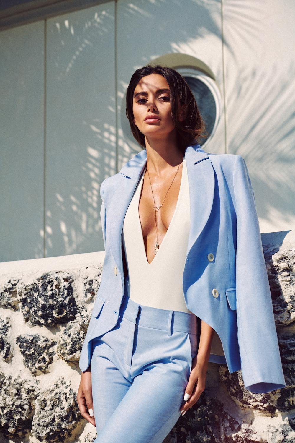 Blue classic elegant women's suit. Business outfit for spring-summer season