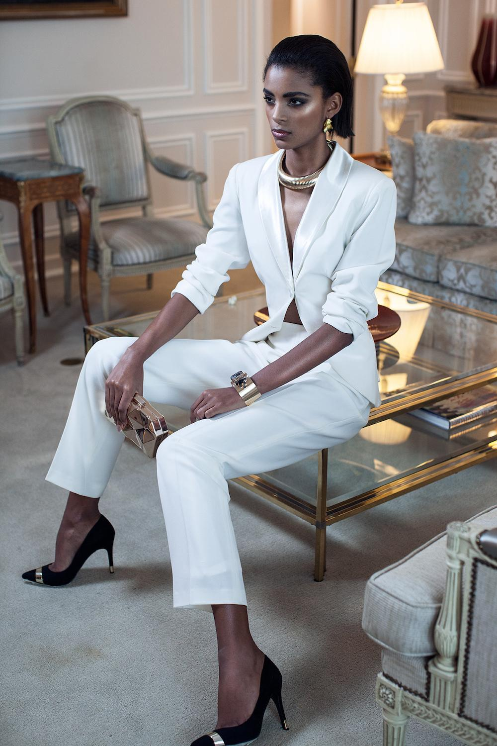 White elegant classic women's suit. Business outfit for spring-summer season