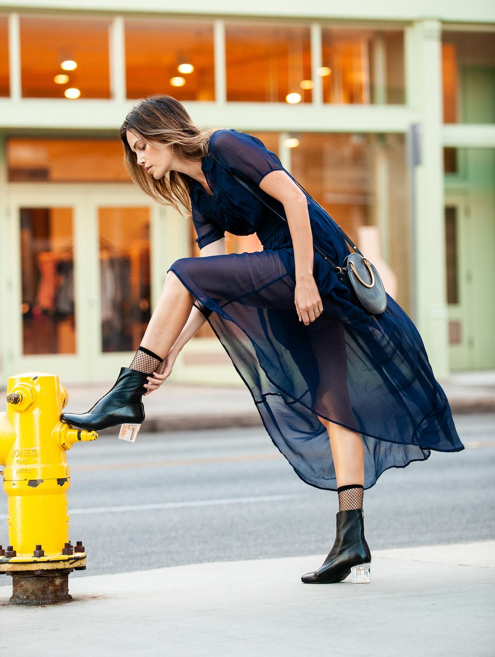Full-length translucent sundress perfect pairs with leather booties