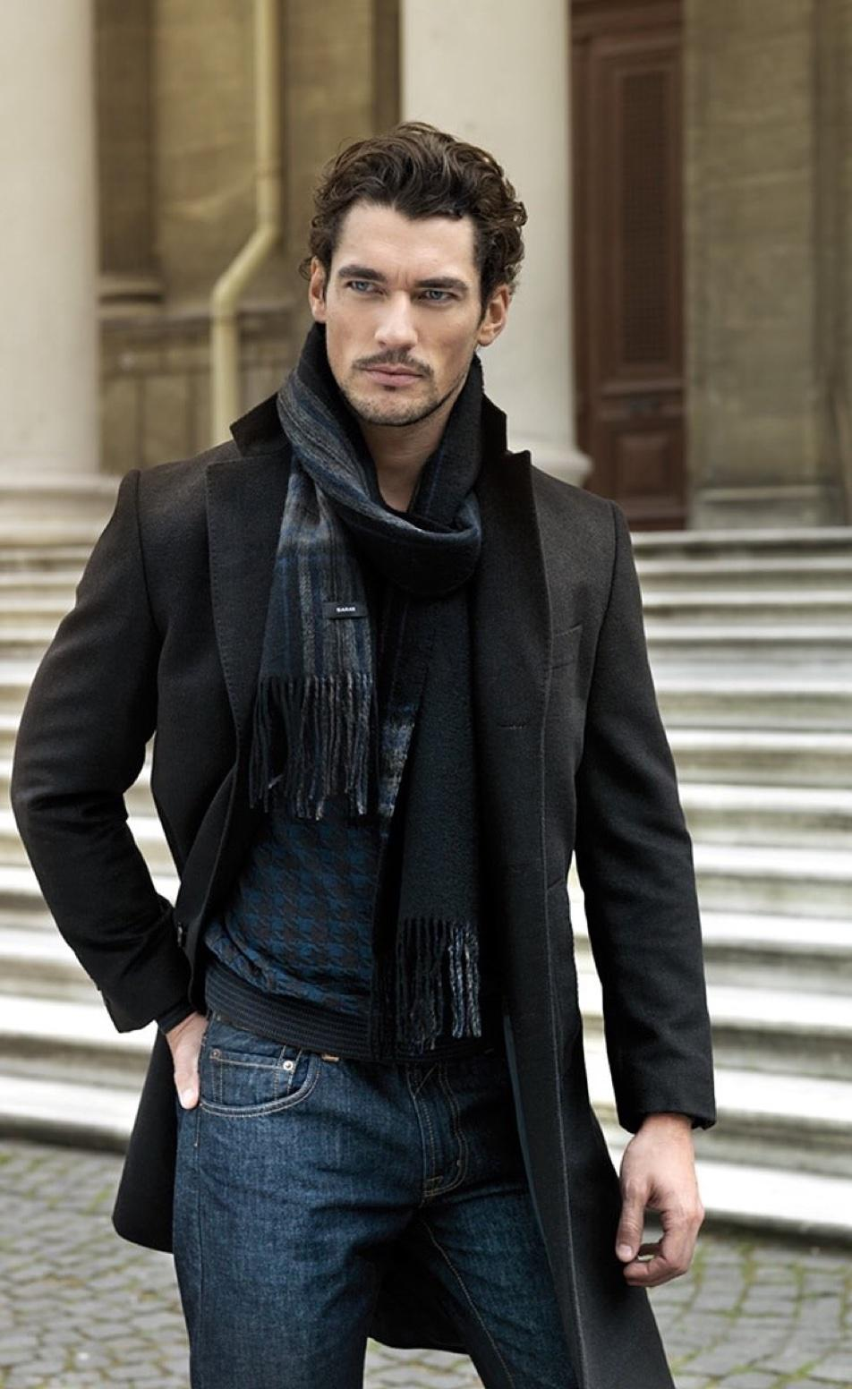 A long dark coat is a great match for a classic grey scarf
