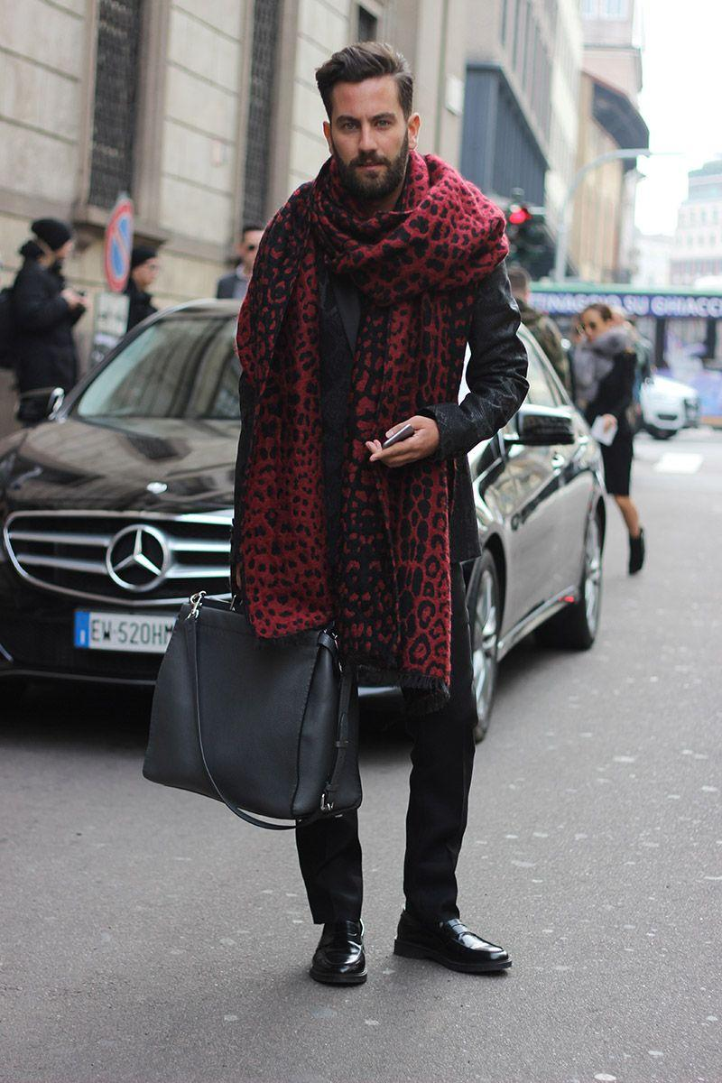 Red scarf with a leopard pattern is the main accent of the look