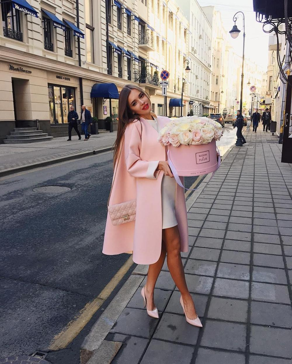 Khristina Belous with roses in romantic pink