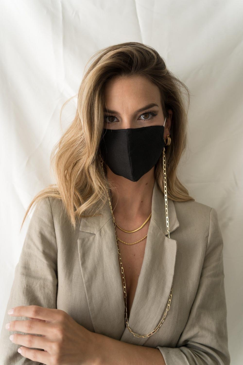 Classic black mask with chain as a fashion accessory