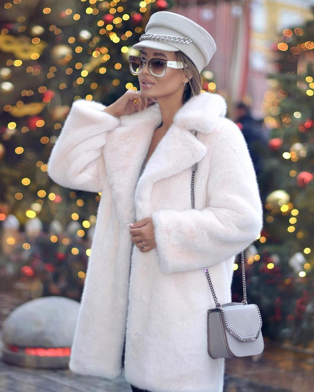 A medium-length white fur coat will go well with any outfit