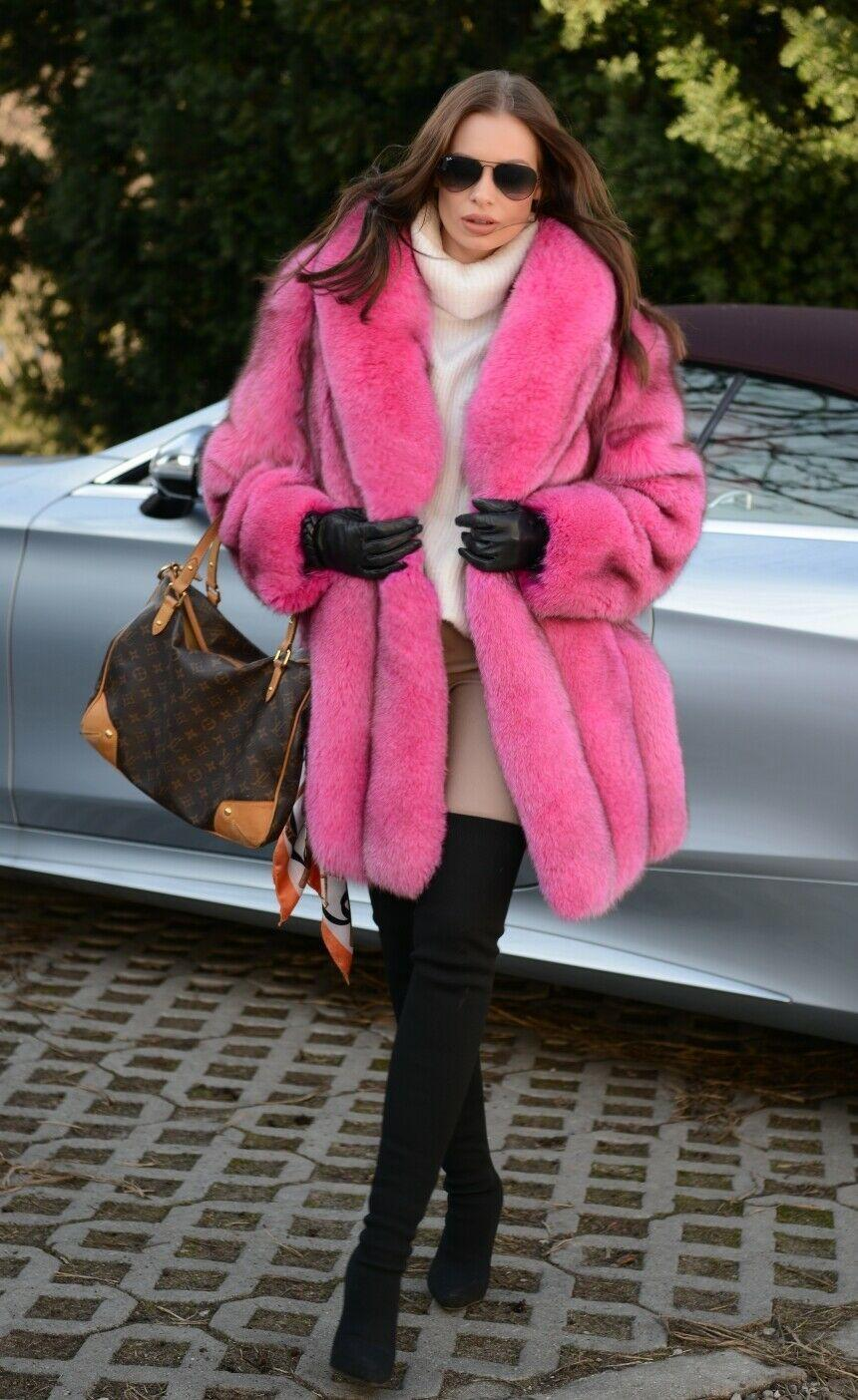 A bright pink fur coat is exactly what you need this winter