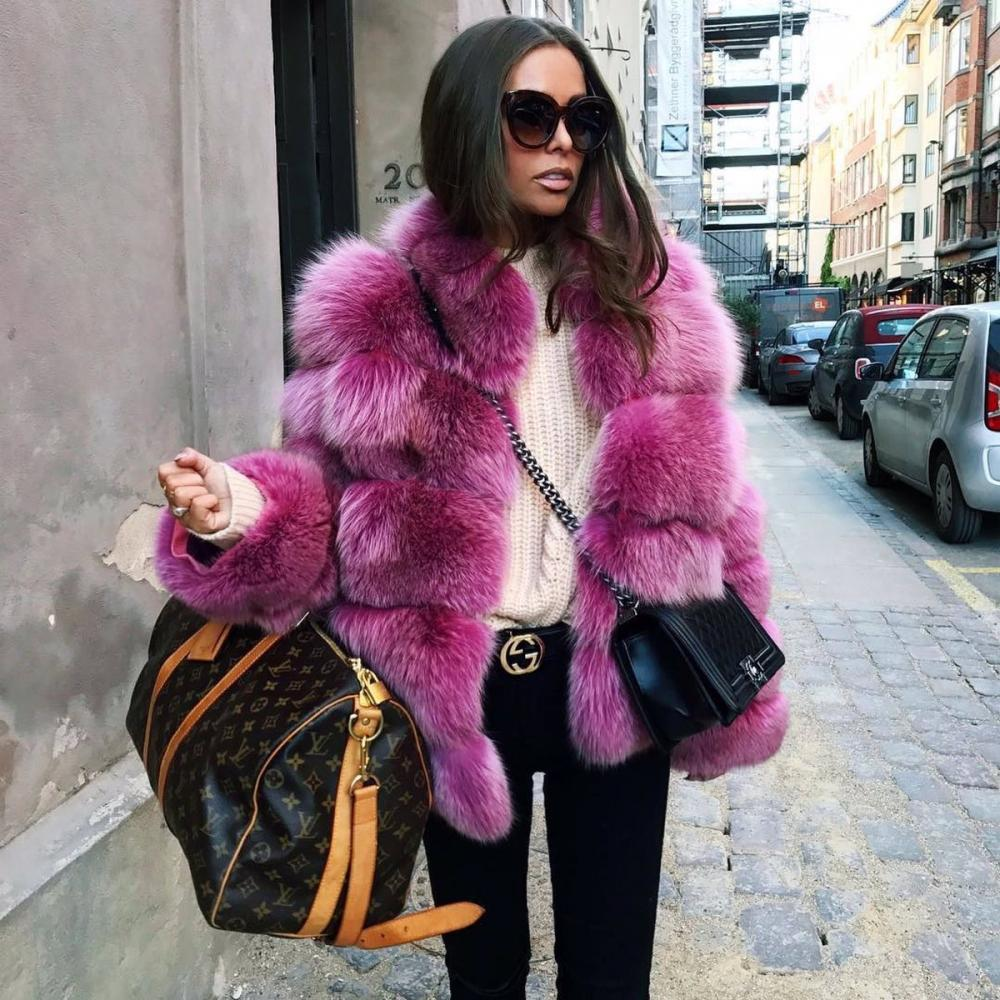 Fuchsia faux fur coat is a bright contrast for a black and white outfit