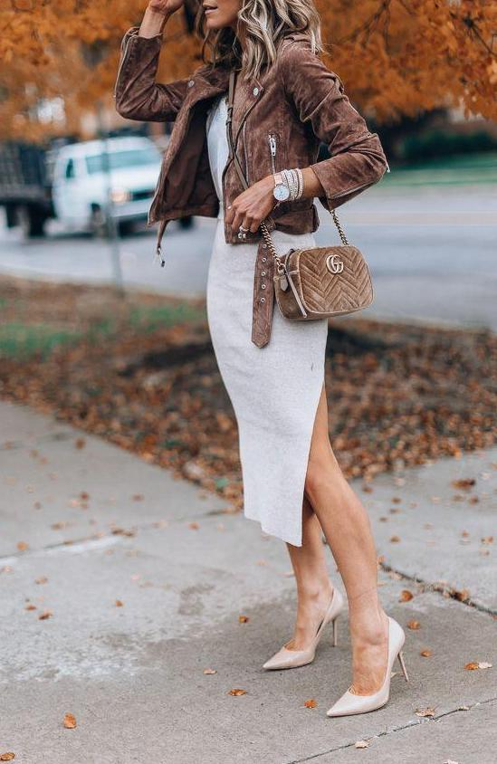 A suede brown jacket over a white dress looks amazing